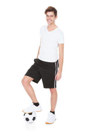 football socks: Portrait Of A Soccer Player Holding Football On White Background