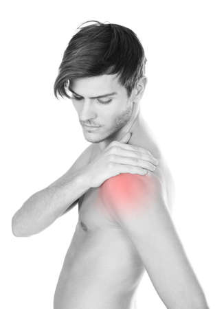 Shirtless Young Man Suffering From Shoulder Pain On White Background