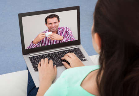 Close-up Of A Woman Video Chatting With Young Man Stock Photo - 23752387