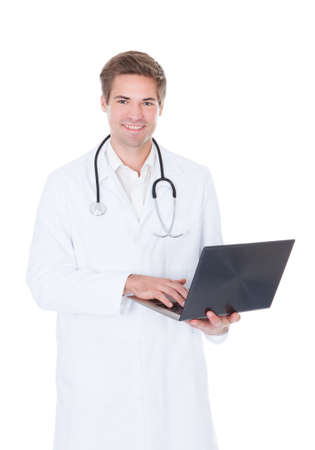 Happy Young Doctor Using Laptop Over White Background photo