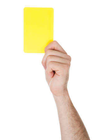 Closeup Of Male Soccer Referee Hand Holding Yellow Card photo