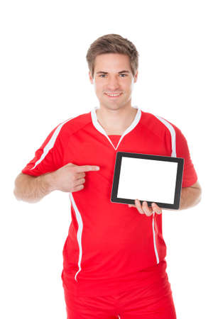 Portrait Of A Soccer Player Presenting Tablet photo