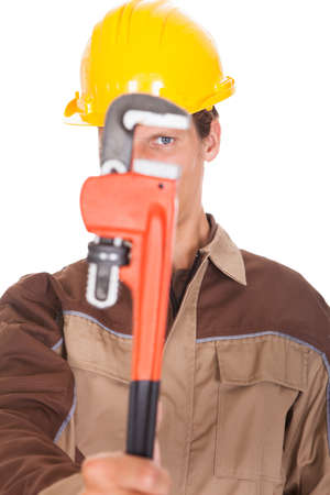 Portrait Of Happy Young Worker Wearing Yellow Hardhat On White Background photo