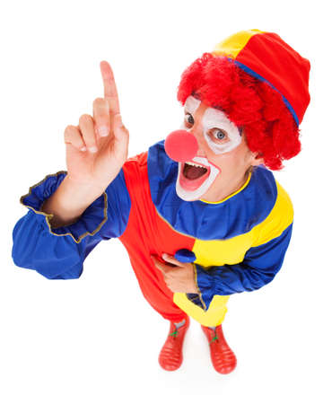 clown face: High Angle View Of A Joker Raising Finger Over White Background