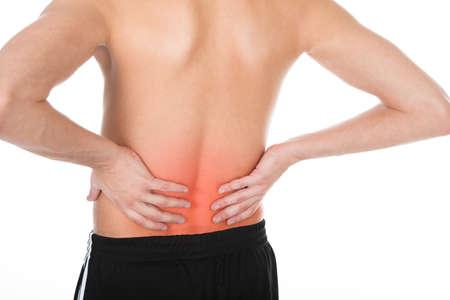 osteoporosis: Hombre joven descamisado con su espalda Sobre Fondo Blanco