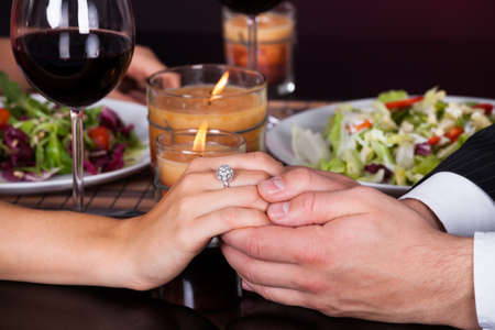 romantic evening with wine: Young Smiling Couple Having Dinner With Wine Glass On Table