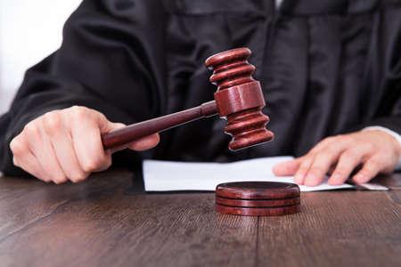 judge hammer: Close-up Of A Judge Hitting Mallet At Desk