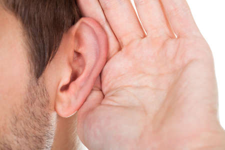 listening ear: Close-up Of Person Trying To Hear With Hand Over Ear