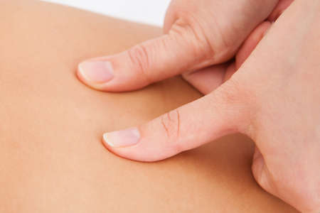 acupressure hands: Closeup Of Person Receiving Shiatsu Treatment From Massager Stock Photo