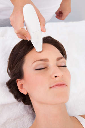 Young Attractive Woman Undergoes Microdermabrasion Therapy In Spa photo