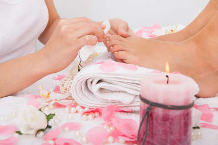 pedicure: Close-up Of Beautician Hand Filing The Nails Of Woman In Salon