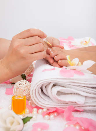 Close-up Of A Beautician Applying Nail Varnish To Womans Feet photo