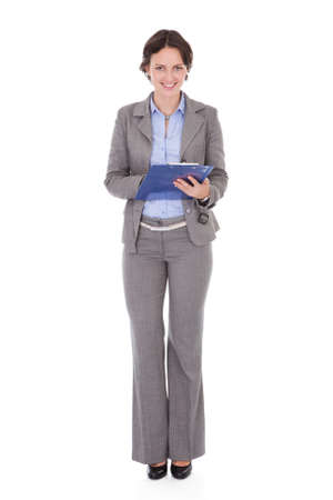 Portrait Of Happy Young Businesswoman With Clipboard