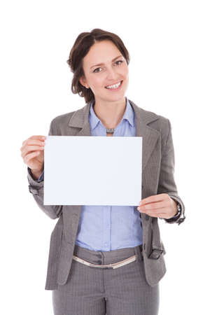 Smiling Businesswoman Holding Placard Over White Background photo