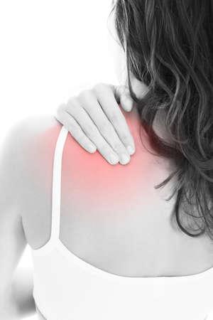 sports massage: Mujer joven con dolor en el hombro sobre fondo blanco Foto de archivo
