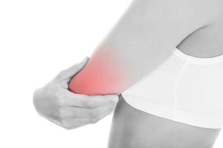 sore muscles: Young Woman With Pain In Her Elbow Over White Background