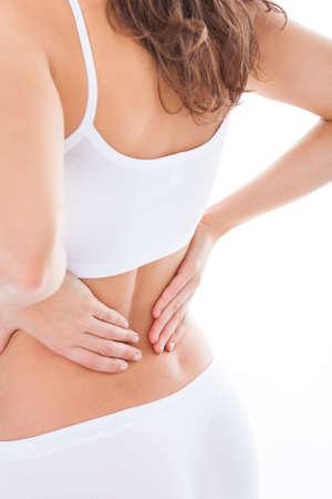 mujeres de espalda: Mujer joven con dolor en la espalda Sobre Fondo Blanco