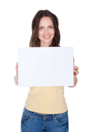 Portrait Of Smiling Woman Holding Placard Over White Background photo