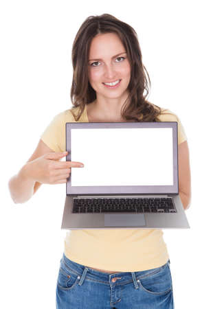 Portrait Of Smiling Woman Holding Laptop Over White Background Stock Photo - 24285194