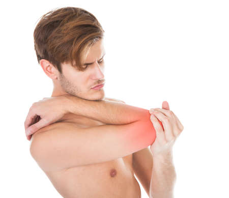 elbow pad: Shirtless Young Man Suffering From Elbow Pain On White Background