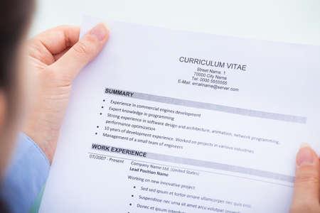 recruit: Close-up Of A Businesswoman Reading Curriculum Vitae Stock Photo