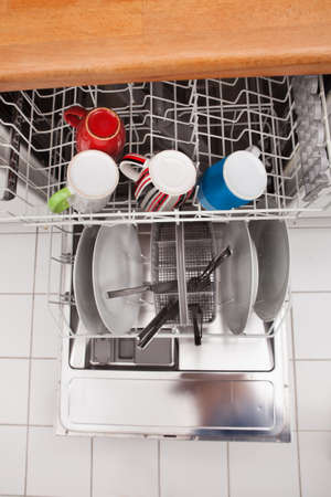 High Angle View Of Utensils In Dishwasher photo
