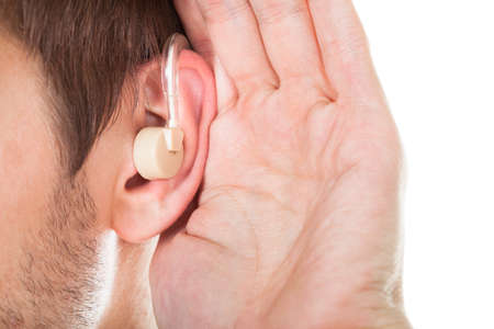 deafness: Close-up Of An Ear With Hearing Aid
