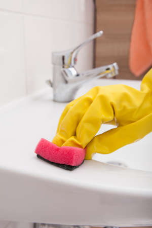 handglove: Close-up Of Hand With Gloves Cleaning Sink