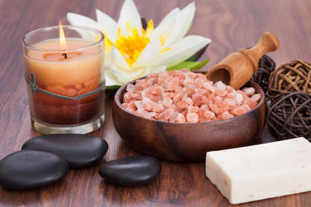 Close-up Of Spa Products With Illuminated Candles On Wooden Table Stock Photo