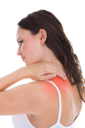 Young Woman With Pain In Her Shoulder Over White Background photo
