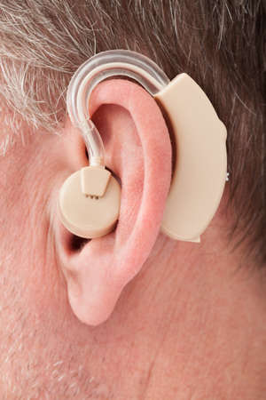 listening device: Close-up Of A Person Wearing Hearing Aid