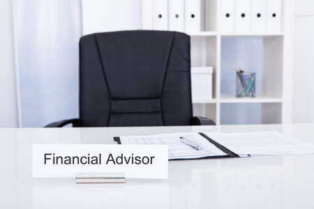name plate: Photo Of Financial Advisor On Nameplate At Workplace