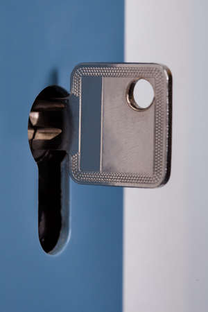 Close-up Of Silver Key In The Keyhole Of Door Stock Photo - 25045403
