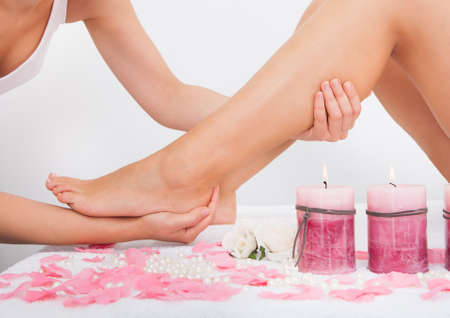 Young Woman Getting Feet Massage Treatment At Spa Stock Photo - 25045420