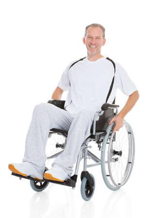 Portrait Of A Mature Man Sitting On Wheelchair