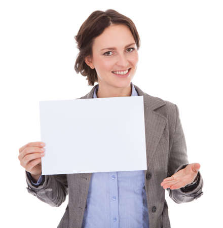 Smiling Businesswoman Holding Placard Over White Background Stock Photo - 25045446