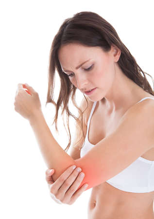 arm pain: Young Woman With Pain In Her Elbow Over White Background