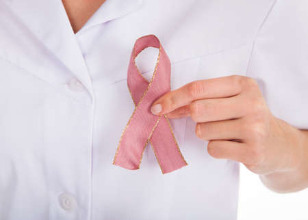Close-up Of A Doctor Holding Ribbon Formed Aids Symbol Stock Photo - 25045475