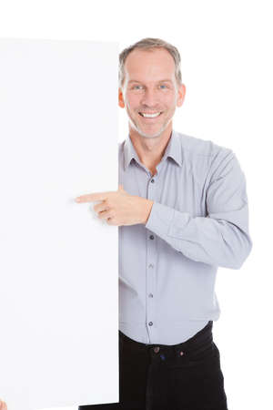 Happy Mature Man Holding Blank Placard Over White Background photo