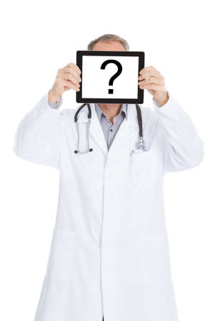 Portrait Of Mature Male Doctor Showing Digital Tablet With Question Mark photo