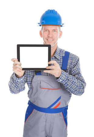 Portrait Of Male Architect Showing Digital Tablet On White Background photo