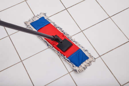 brooming: Close-up Of The Mop Washing The Tile Floor