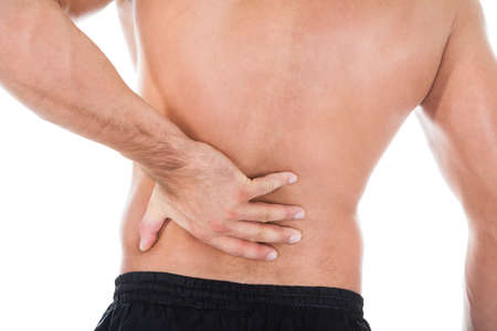 back strain: Rear View Of Young Man Suffering From Back Pain Stock Photo