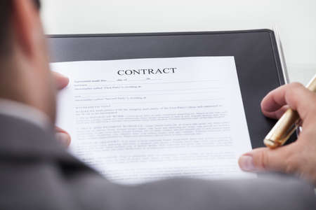 person looking: Close-up Of A Person Looking At Contract Form Holding Pen Stock Photo