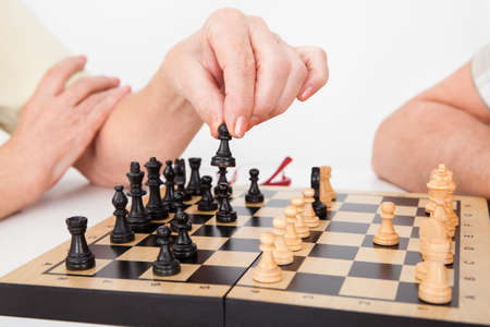 chess player: Senior Woman Playing Chess With Her Husband