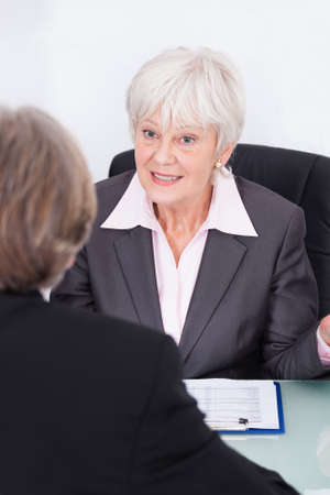 Mature Businesswoman And Businessman Discussing At Workplace photo
