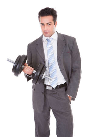 Portrait Of Young Businessman Exercising With Dumbbells photo