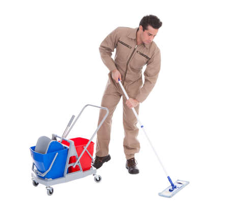 Young Male Sweeper Cleaning Floor On White Background Stock Photo