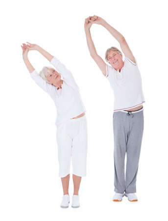 senior exercising: Happy Healthy Senior Couple Exercising With Extending Hand