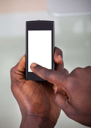 Close-up Of A Person Holding Cellphone With Blank Screen photo